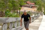 Climbing up the White Buddha (Wat Phra That Mae Yen)